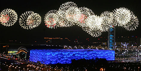 Fireworks go off over the National Aquatics Center, known as the Water Cube, during a rehearsal Saturday in Beijing for the opening ceremony of the 2008 Olympic Games.