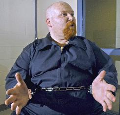 Richard Cooey, shown here in 2003, is on death row for the 1986 murders of two University of Akron students. Attorneys for Cooey argued in a federal lawsuit he's so fat that Ohio executioners would have trouble finding his veins.