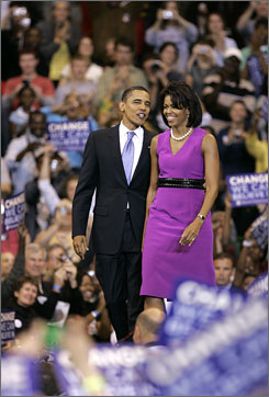Michelle Obama arrives with her husband, Democratic presidential candidate, Sen. Barack Obama, D-Ill., before he speaks at a primary night rally in St. Paul, Minn., in June.