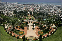 Visitors walk in the gardens in the Baha'i temple in Haifa, Israel, July 14. An UNESCO committee named the Bahai shrines in Haifa and Akko official World Heritage Sites this year.