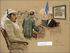 Defendant Salim Hamdan listens to FBI agent Craig Donnachie testify July 24 at his trial at Guantanamo Bay. Jurors got the case Monday.