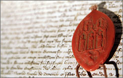 A replica of one of three seals used by inquisitors at a trial 700 years ago, in which Pope Clement V absolved the Knights Templar of charges of heresy, is seen in Rome.