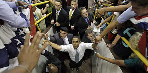 "Sen. Barack Obama greets attendees as he leaves a town-hall-style meeting at Baldwin-Wallace College in Berea, Ohio. Obama wants ""safer ways to use nuclear power."""