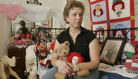 Dee Ryan holds stuffed animals her daughter Aslyn loved before she died four years ago. The one-year-old died when a babysitter left her in a hot car to run errands, and Ryan has fought since then for hyperthermia awareness.