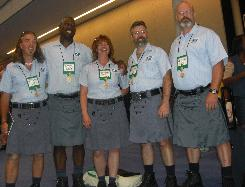 Dean Peterson, right, and his kilt compadres model prototype postal uniforms at the National Association of Letter Carriers' July convention in Boston, where Peterson introduced a resolution to add kilts to the available uniform choices. The resolution was defeated, but Petersen vows to take the fight to the 2010 meeting.