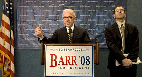 Former congressman Bob Barr left, appears with constitutional law expert Bruce Fein at the National Press Club on June 25 in Washington.