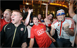 Manchester United soccer fans celebrate a win over the Chelsea Football Club in May.  Despite the sport's popularity there, the U.K. hasn't fielded an Olympic team in 44 years.