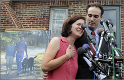 Berwyn Heights, Md., Mayor Cheye Calvo, right, is asking for the U.S. Justice Department to investigate a county police raid on his home during which his dogs were killed. Calvo is pictured with his wife Trinity Tomsic at a news conference at their house in Berwyn Heights on Thursday.