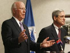 Sen. Patrick Leahy, D-Vt., spoke Thursday with FBI Director Robert Mueller about being targeted in 2001 by one in a series of anthrax-laced letters. The government has declared Army scientist Bruce Ivins the culprit in those attacks but has continued to seek evidence against him, searching two computers Thursday.