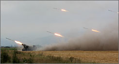 Georgian troops fire rockets at South Ossetian troops from an unnamed location on Friday.