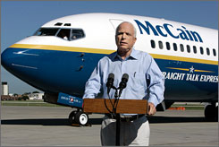 Republican presidential contender John McCain, seen here addressing reporters Friday in Des Mones, Iowa, is slated to raise funds in Arkansas for his campaign.