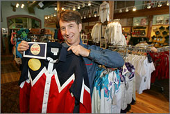 Steve Weil, one of the owners of Rockmount Ranch Wear, holds a western-style shirt and a copy of a logo for the Democratic National Covention in his downtown Denver store on Wednesday, Aug. 6, 2008.  There is talk of the road to the White House running through the West, and Denver will be a major stop along that route when the Democratic National Convention comes to town Aug. 25-28.