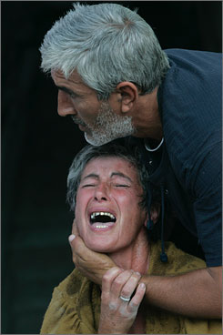 An unidentified Georgia woman is calmed by her husband Monday in Gori, Georgia, just outside of South Ossetia.