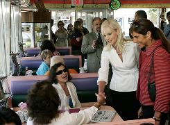 New Jersey Sen. Jennifer Beck, right, accompanies Cindy McCain on Tuesday as she greets patrons during lunch hour at the Broadway Diner in Red Bank, N.J