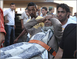 Lebanese men help an injured man at the scene of a bomb explosion in the northern city of Tripoli.