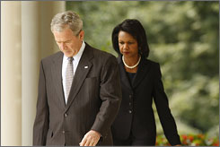 President Bush said Wednesday from the White House grounds that he is sending Secretary of State Condoleezza Rice to Georgia to express solidarity with the country. Here, the president and Rice are seen walking to the Rose Garden just before he made his statement.