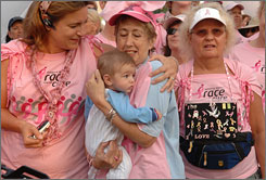 Breast cancer survivor Fran Staiman holds 6-month-old Ethan Kahl as she's hugged by Ethan's mom, Rana Kahl, also a breast cancer survivor, during the 2007 Susan G. Komen Race for the Cure in Washington. Women who survive breast cancer five years have a relatively low relapse rate.