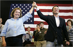 Sen. John Edwards, D-N.C., right, and his wife Elizabeth arrive at a campaign rally in Ames, Iowa, in January 2008. Edwards admitted to an extramarital affair while his wife was battling cancer.