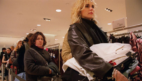 Women wait in line to use the fitting rooms at H&M on New York's Fifth Avenue. Nearly two-thirds say shopping for clothes is bad for their self-confidence, according to a Fitness magazine poll.