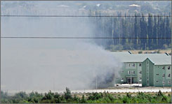 Georgia charges that Russia is sending tanks into the city of Gori in spite of an agreement to stop aggressions. Here, smoke is seen rising from a Georgian army base outside Gori on Wednesday.