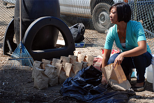 Fran Avendana, 21, a student at University of California, San Diego, sorts compost as part of the schools recycling program.