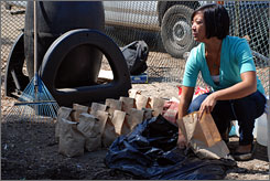 Fran Avendana, 21, a student at University of California, San Diego, sorts compost as part of the school?s recycling program.