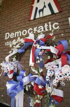 A wreath sits in front of the Arkansas Democratic Party headquarters in Little Rock, as a memorial to state Democratic Party Chairman Bill Gwatney, who was fatally shot at his office Wednesday.