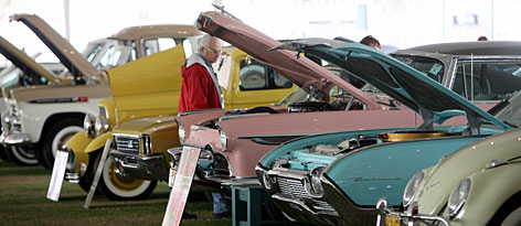 A man checks out antique cars at an auction in Scottsdale, Ariz., last January.