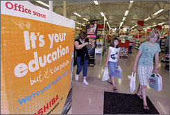 Shoppers leave an Office Depot in Mountain View, Calif., after purchasing school supplies. With schools tightening their budgets, some parents are being asked to provide even more classroom supplies, as well as provide carpooling to athletic events and field trips and pay for bus fuel.