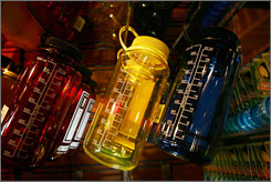 Nalgene water bottles hang on display at an outdoor supply store in Arcadia, Calif. Nalgene and other manufacturers began phasing out the chemical bisphenol A in their bottles because of consumer concern.