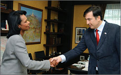 Secretary of State Condoleezza Rice says that a draft truce she has brought with her to Georgia protects that country. Here, Rice is seen meeting with Georgia President Mikheil Saakashvili on Friday.