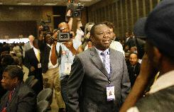 Zimbabwean opposition leader Morgan Tsvangirai, center, arrives at the opening ceremony of the 28th summit of SADC heads of state and government in Sandton, South Africa.