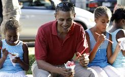 Democratic presidential candidate Sen. Barack Obama, D-Ill., eats shaved ice Aug. 13 with his daughters Sasha Obama, 7, left, and Malia Obama 10, at Island Snow in Kailua, Hawaii.
