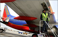 Swissport employee Steve Surla prepares to pump fuel into a Southwest Airlines plane at Oakland International Airport in Oakland, California.