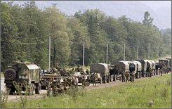 A column of Russian troops stops for a short rest while traveling in the direction of Tskhinvali, near the town of Alagir, Georgia.
