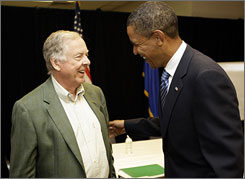 Sen. Barack Obama, D-Ill., right, talks with T. Boone Pickens before their meeting to discuss energy issues.