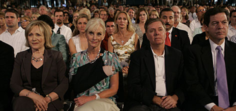 Kay Warren, left, wife of pastor Rick Warren, Cindy McCain, second from left, Sen. Lindsey Graham, R-S.C., second from right, and Sen. Sam Brownback, R-Kansas, were among those who attended the Compassion Forum.