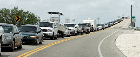 Motorists, including many tourists, take the slow route out of Fiesta Key, Fla., on Sunday with Tropical Storm Fay on track to build strength.