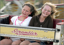 Kayla Shepherd, left and Jenna Schutte, both 12 and from Waverly, Iowa, ride the Scrambler at the Bremer County Fair in Waverly in July.