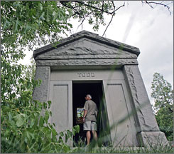 Bob Markiewicz stands at a Riverview cemetery mausoleum, in Wilmington, Del., whose metal gate was stolen in July.