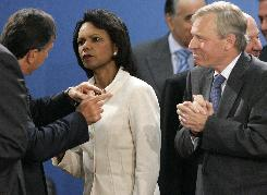 U.S. Secretary of State Condoleezza Rice talks Aug. 19 with Italy's counterpart Franco Frattini, left, as NATO Secretary General Jaap De Hoop Scheffer listens during an emergency NATO foreign minister meeting in Brussels.