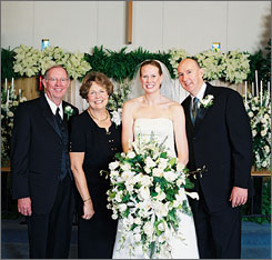 Barbara Bachman, second from left, is beginning to walk as she recuperates at the Mayo Clinic in Minnesota from a stabbing in Beijing. Here, Bachman is seen at the December 2006 wedding of her daughter, Elisabeth Bachman McCutcheon, second from right, to Hugh McCutcheon, far right, coach of the U.S. mens' volleyball team at the Olympics. At the far left is Bachman's husband, Todd Bachman, who died in the Aug. 9 stabbing attack in Beijing.