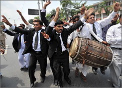 Pakistani lawyers celebrate the resignation of President Pervez Musharraf during a rally Tuesday. The leader quit Monday.