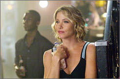 Christina Applegate in a scene from her new movie The Rocker. The 36-year-old actress is part of a growing group of women who choose to get a mastectomy instead of radiation in hopes of improving their chances against breast cancer.