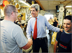 Nearly four years after his failed presidential bid, Sen. John Kerry, D-Mass., is seeking reelection. Here, Kerry greets a current and a former employee of Cicycle Alley in Worcester, Mass., on Monday.