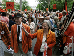 Princeton University's President Shirley M. Tilghman waves as she marches with alumni during the P-rade in Princeton, N.J., May 31.