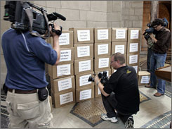 TV crews in Lincoln, Neb., in July document boxes full of signed petitions to ban most types of affirmative action in the state. Nebraska Secretary of State John Gale said Friday that the Nebraska Civil Rights initiative had 136,589 valid signatures, enough signatures for the initiative to appear on the November ballot.