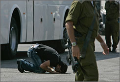 Israel has released 200 Palestinian prinsoners. Here, one of them kisses the ground at Beituniya checkpoint before leaving for Ramallah in the West Bank.