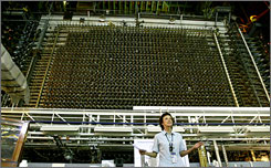 Tour guide Michele Gerber explains the scale of the Hanford nuclear project in 2007 standing in front of B Reactor's 46-foot square reactor front face block.