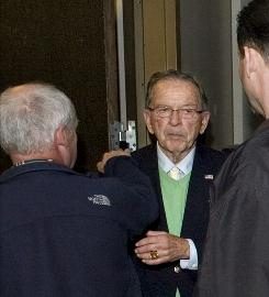 Sen. Ted Stevens shakes hands with supporters as they leave a fundraising luncheon at Centennial Hall in Juneau, Alaska, on Friday.
